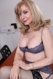 Free porn pics of Nina Hartley in sexy black stocking 1 of 28 pics